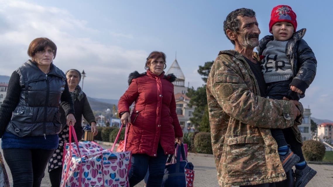 Refugees are seen upon their arrival from Yerevan, on November 17, 2020 in Stepanakert. (AFP)