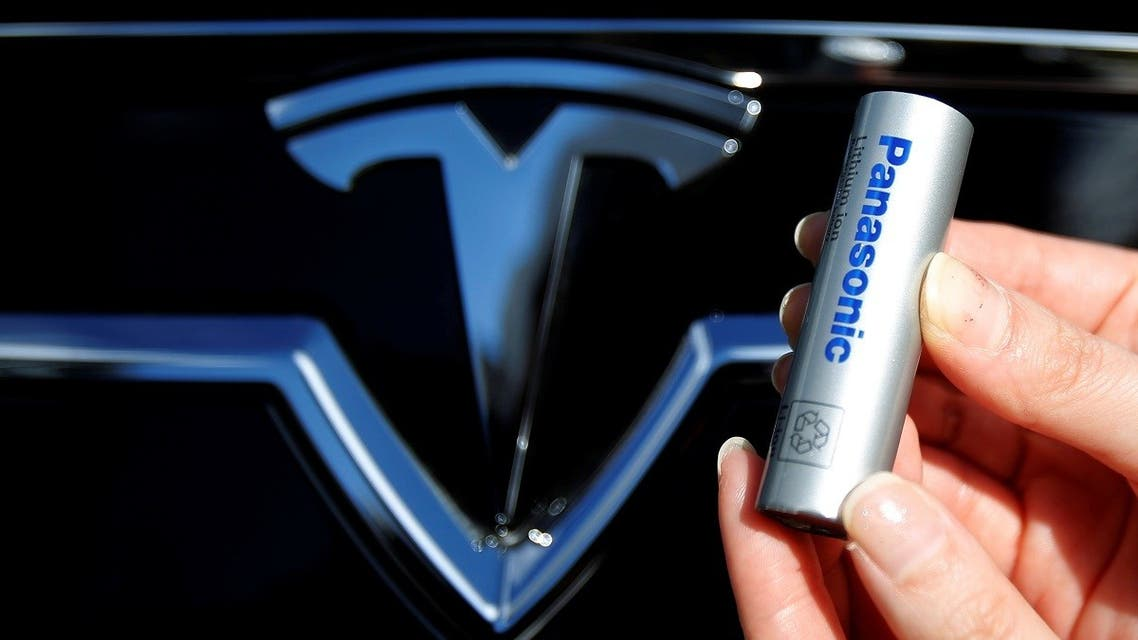 A Panasonic Corp's lithium-ion battery, which is part of Tesla Motor Inc's Model S and Model X battery packs, is pictured with the Tesla Motors logo at the Panasonic Center in Tokyo, Japan. (Reuters)