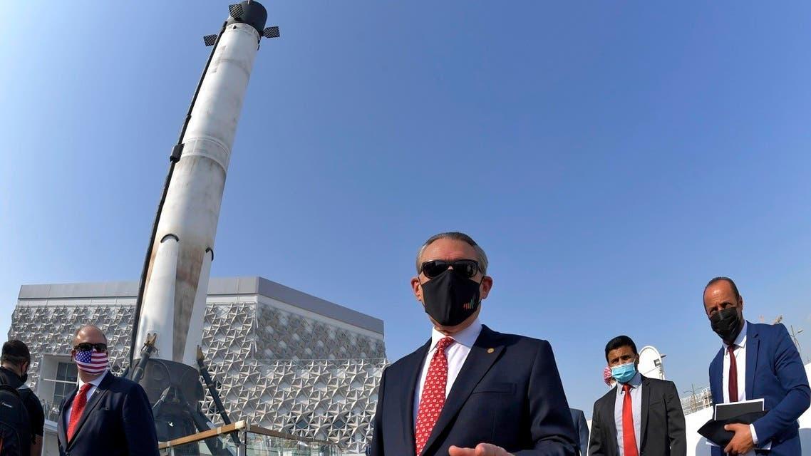 US ambassador to the United Arab Emirates, John Rakolta (C), attends the unveiling of the US pavilion at the Dubai Expo 2020 site, on November 18, 2020. (AFP)