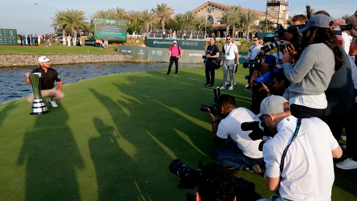 Cameramen film Graeme McDowell from Northern Ireland as he celebrates the trophy after he wins the final round of the Saudi International at Royal Greens Golf and Country Club on Feb. 2, 2020. (File photo: AP)