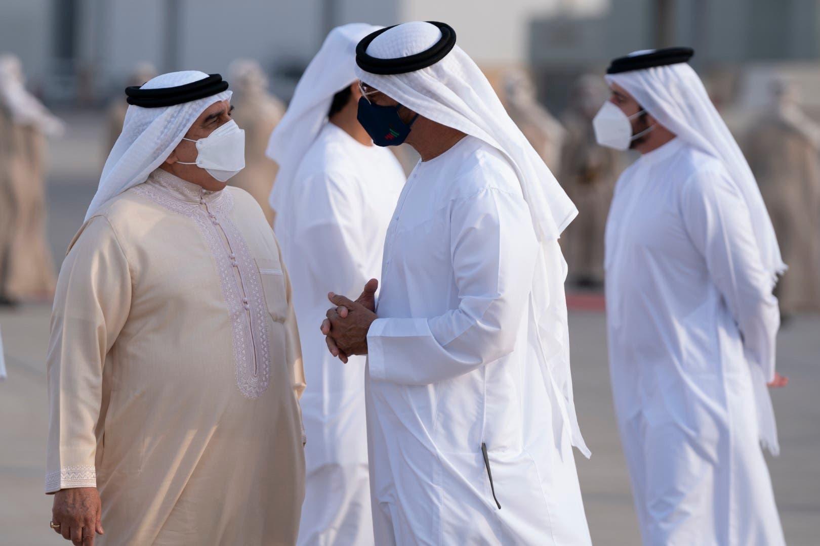 Bahrain's King Hamad bin Isa Al Khalifa arrives in Abu Dhabi, left, to meet Abu Dhabi Crown Prince Sheikh Mohamed bin Zayed Al Nahyan, right. (WAM)