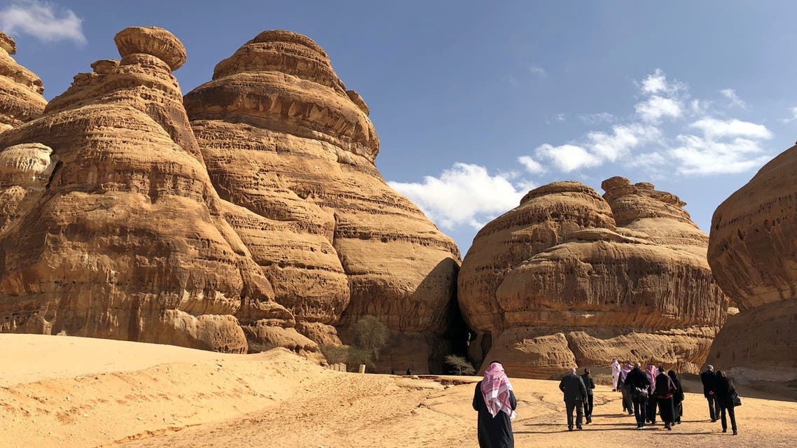 Visitors walk outside the tombs at the Madain Saleh antiquities site, al-Ula. (reuters)