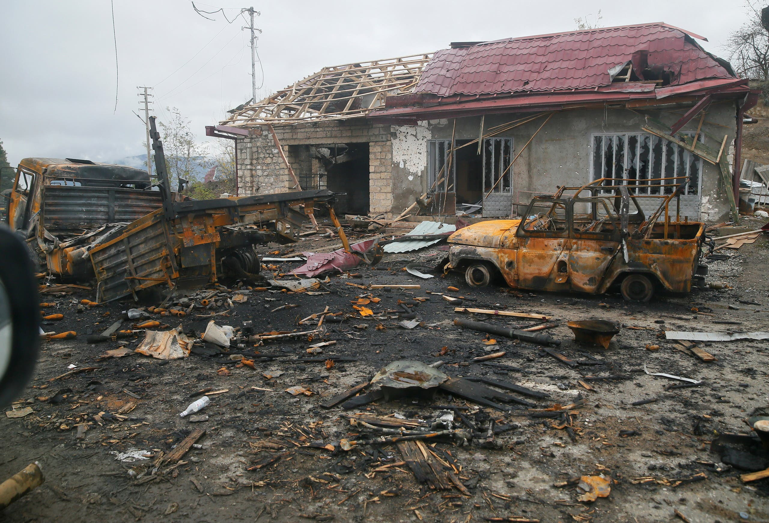 A view shows burnt vehicles and a damaged building on the outskirts of Shusha (Shushi) in the region of Nagorno-Karabakh. (File photo: Reuters)