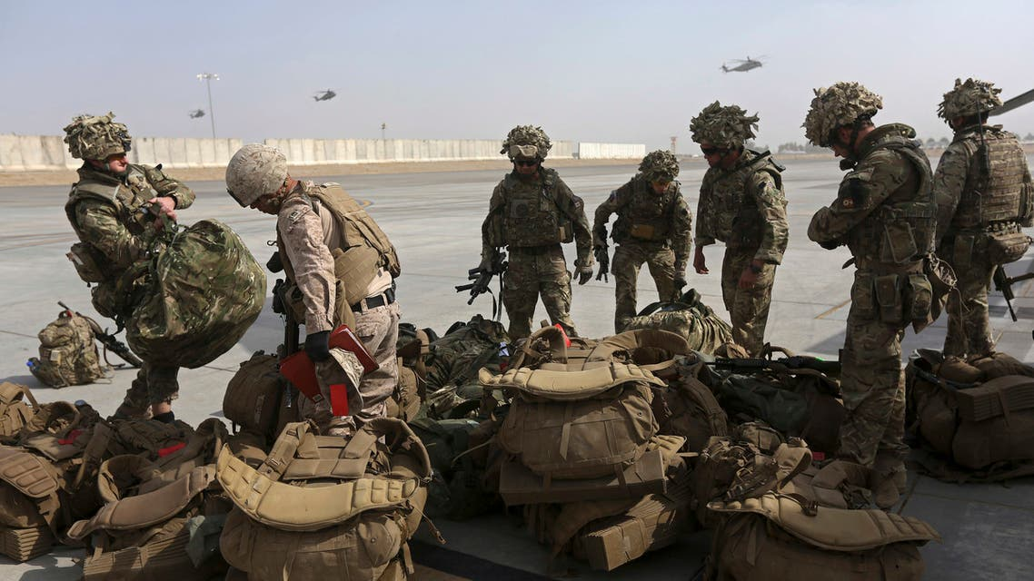 British soldiers arrive at Kandahar air base at the end of operations for U.S. Marines and British combat troops in Helmand. (reuters)