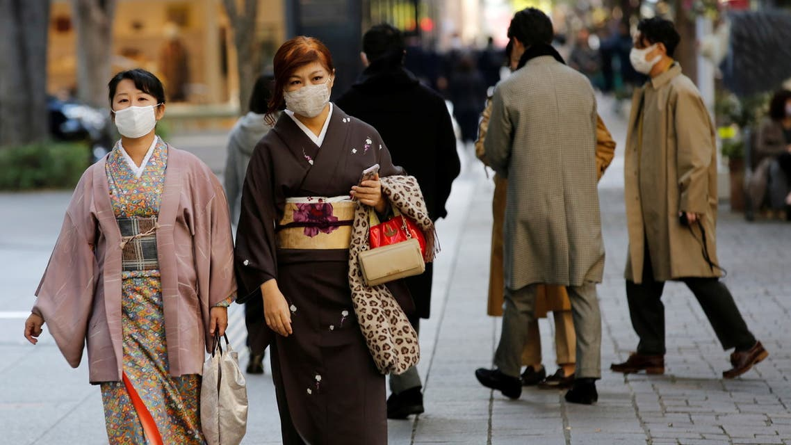 Women wearing Kimono and protective masks, following the coronavirus disease (COVID-19) outbreak, walk in Tokyo, Japan November 13, 2020. (Reuters)