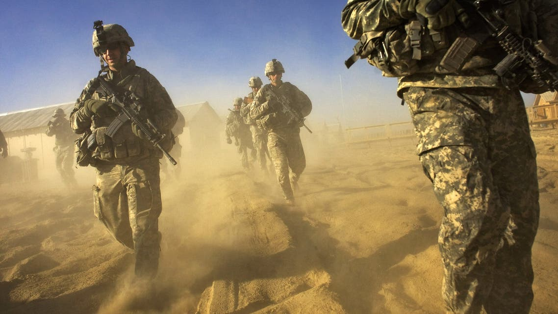 (FILES) In this file photo taken on November 28, 2008, US Army soliders from 1-506 Infantry Division set out on a patrol in Paktika province, situated along the Afghan-Pakistan border. The Pentagon on November 19, 2020 announced plans to slash troop levels in Afghanistan to its lowest levels in nearly 20 years of conflict after President Trump pledged to end a war that has killed about 2,400 US soldiers and cost the American taxpayer more than $ 1 trillion since 2001.