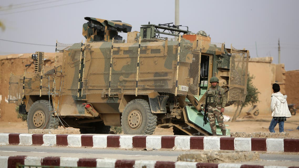 A Turkish soldier stands near his armoured vehicle on a highway near the northern Syrian town of Ain Issa in the countryside of the Raqqa region, on November 26, 2019, as Turkey-backed forces deploy reinforcements around the key town. Ankara and its Syrian proxies launched on October 9 a cross-border attack against Kurdish fighters in northern Syria, which allowed Turkey, along with a subsequent Russian-Turkish accord, to control a strip of land on the Syrian side of the border. Ain Issa lies on the southern edge of that strip of land, on the key M4 highway that runs east to west across the northern part of the war-torn country.
