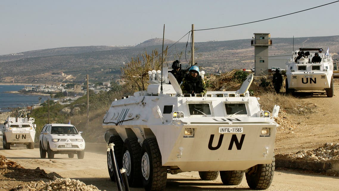 United Nations Interim Force in Lebanon (UNIFIL) vehicles patrol the Lebanese-Israeli border near the village of Ras al-Naqura on December 16, 2013 following crossfire between Israeli and Lebanese forces the previous evening. The Israeli army said it fired across the Lebanese border in retaliation after accusing Lebanese troops of gunning down one of its soldiers as he drove near the frontier. AFP PHOTO / MAHMOUD ZAYYAT