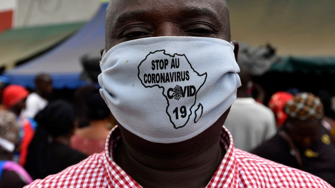 A man wears a stop coronavirus face mask with a map of Africa on it, April 24, 2020 in a street of Abobo, a district of Abidjan. (AFP)
