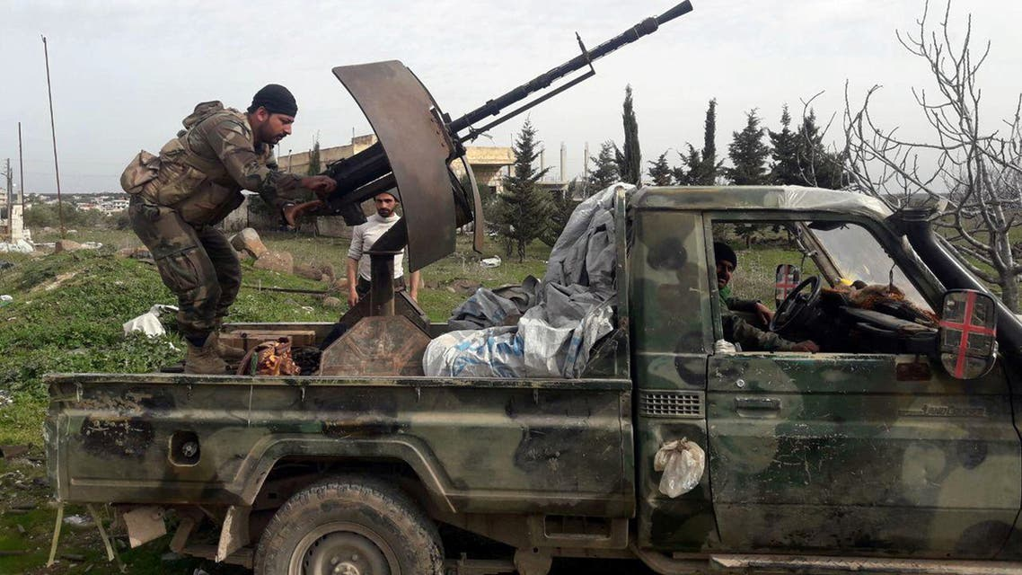 Syrian army soldiers gesture from a military vehicle in southern Idlib province, Syria in this handout released by SANA on March 5, 2020. SANA/Handout via REUTERS ATTENTION EDITORS - THIS IMAGE WAS PROVIDED BY A THIRD PARTY. REUTERS IS UNABLE TO INDEPENDENTLY VERIFY THIS IMAGE