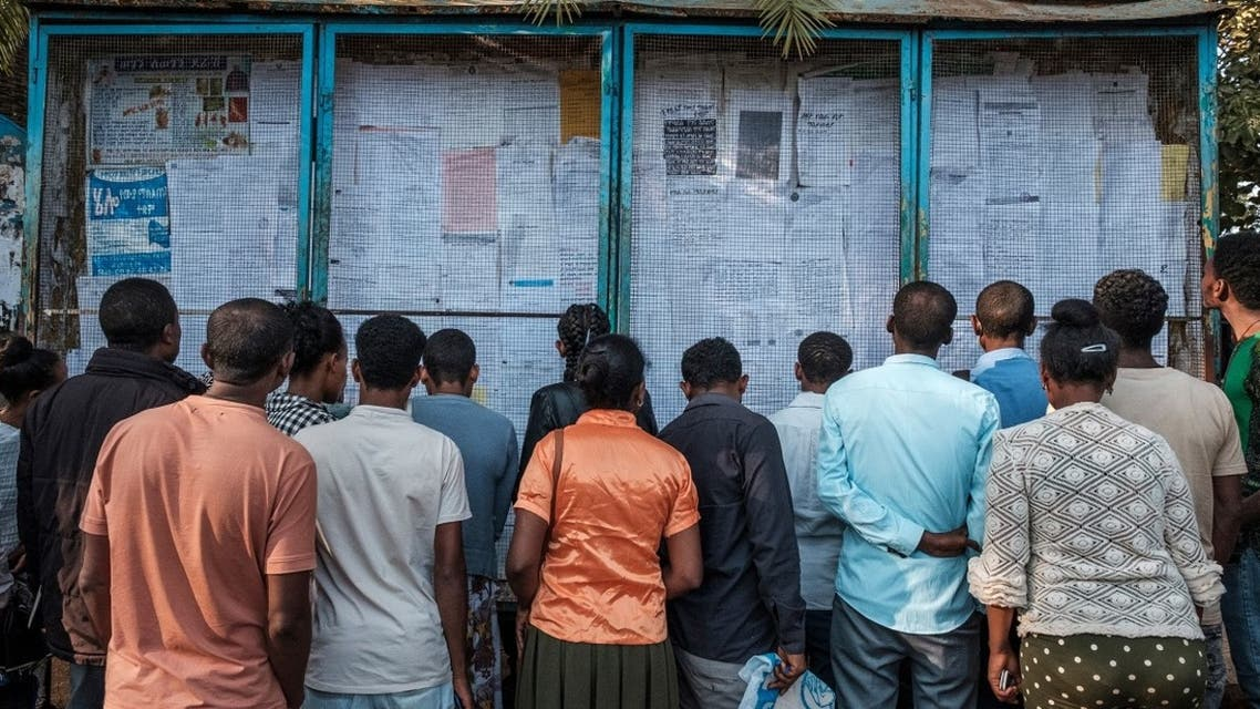 People look at a jobs advertisements board in the city of Bahir Dar, Ethiopia, on Nov. 19, 2020. (AFP)