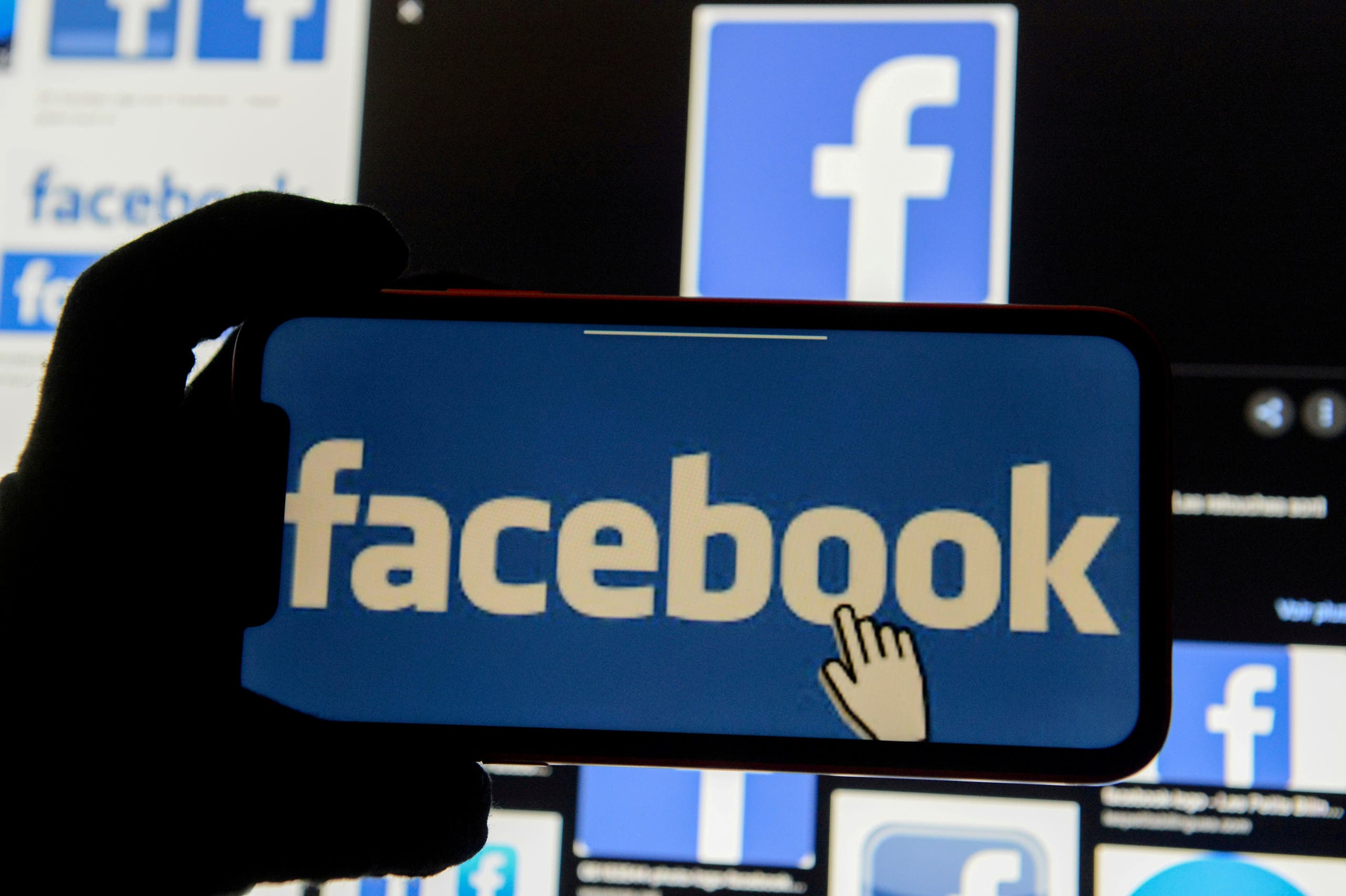 The Facebook logo is displayed on a mobile phone in this picture illustration taken December 2, 2019. (Reuters/Johanna Geron/Illustration)