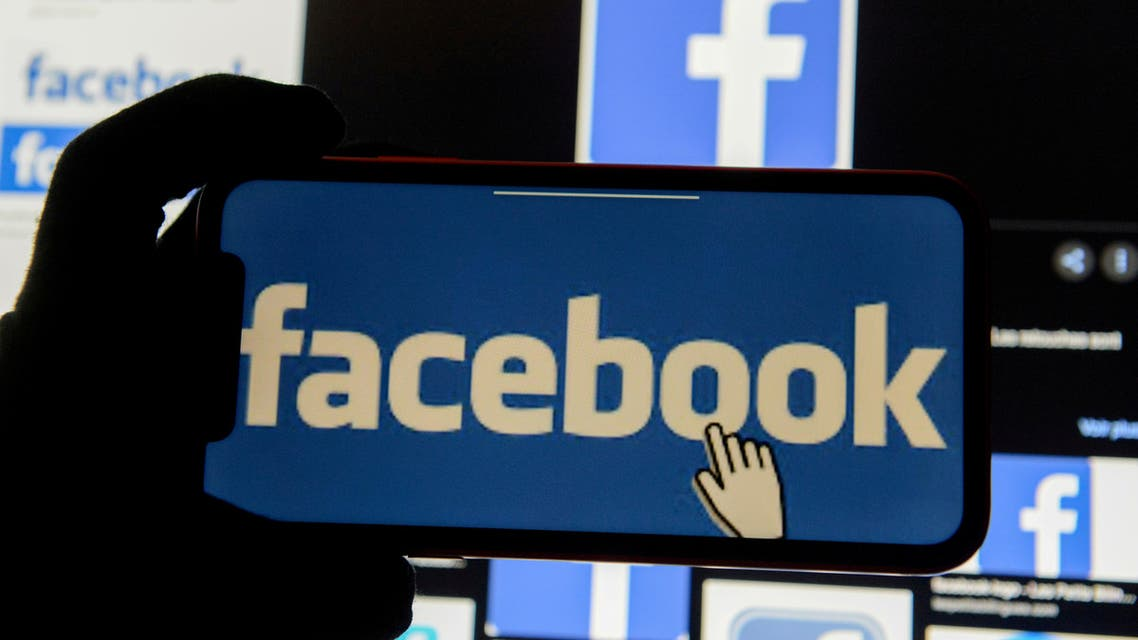 The Facebook logo is displayed on a mobile phone in this picture illustration taken December 2, 2019. (Reuters)