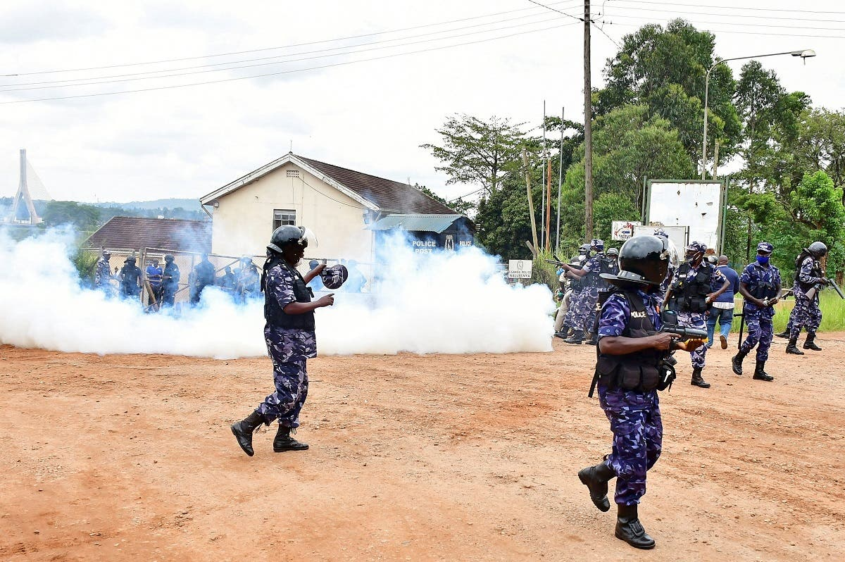 Ugandan riot policemen fire tear gas canisters to disperse supporters of presidential candidate Robert Kyagulanyi, also known as Bobi Wine, in Luuka district, eastern Uganda, on November 18, 2020. (Reuters)