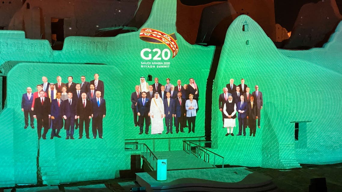 Family Photo for annual G20 Summit World Leaders is projected onto Salwa Palace in At-Turaif, one of Saudi Arabia?s UNESCO World Heritage sites, in Diriyah, Saudi Arabia, November 20, 2020. REUTERS/Nael Shyoukhi