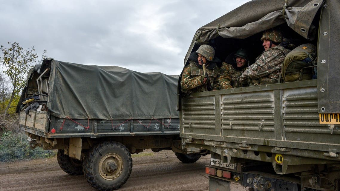 Armenian soldiers leave Agdam in a truck on November 19, 2020 as the territory is due to be returned to Azerbaijan on November 20, 2020 as stipulated in a Moscow-brokered peace deal signed by Armenia and Azerbaijan on November 9. For three decades Azerbaijan's Aghdam district has been under the control of Armenian separatists, who have also governed the neighbouring region of Nagorno-Karabakh since a post-Soviet war in the 1990s.