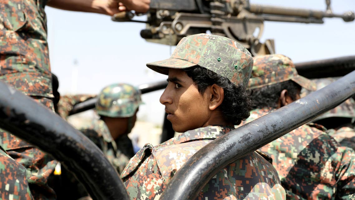 FILE PHOTO: A police trooper rides on the back of a patrol truck during the funeral of Houthi fighters killed during recent battles against government forces, in Sanaa, Yemen September 22, 2020. REUTERS/Khaled Abdullah/File Photo