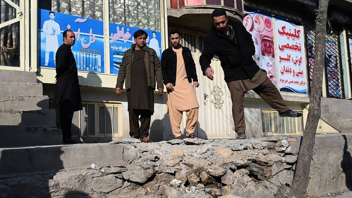 Residents gather at a site after several rockets land at Khair Khana, north west of Kabul on November 21, 2020. (Wakil Kohsar/AFP)
