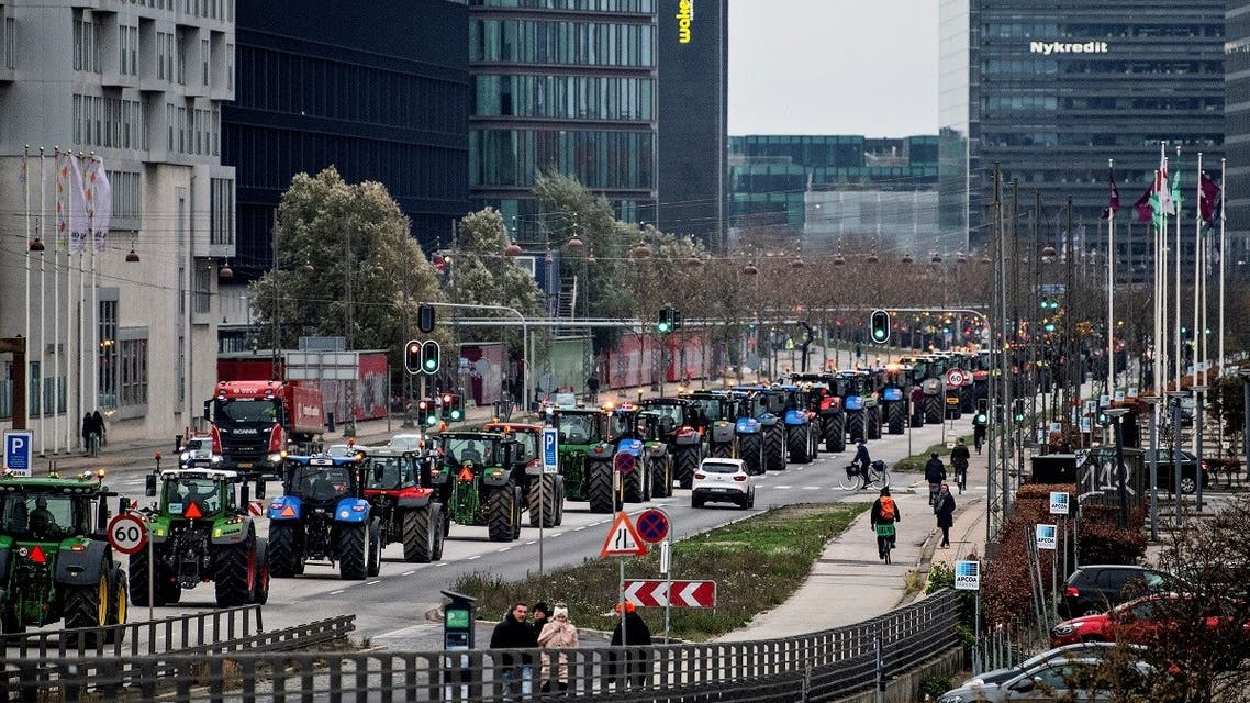 "Farmers in tractors demonstrate against ""abuse of power, lack of respect for the constitution, democratic deficit - and for democracy!"", in Copenhagen, Denmark November 21, 2020. (Nils Meilvang/Ritzau Scanpix/via Reuters)"