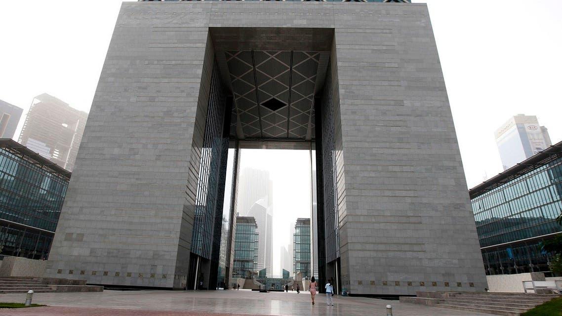 People walk near The Gate building at the financial and business district Dubai International Financial Center (DIFC) in Dubai, February 2, 2012. (Reuters/Jumana El Heloueh)