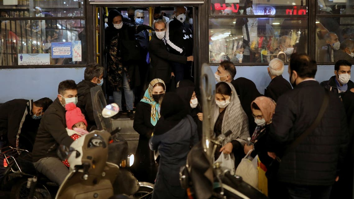Iranian People wearing protective masks are pictured at a bus, amid the outbreak of the coronavirus disease (COVID-19), in Tehran, Iran November 11, 2020. Picture taken November 11, 2020. Majid Asgaripour/WANA (West Asia News Agency) via REUTERS ATTENTION EDITORS - THIS IMAGE HAS BEEN SUPPLIED BY A THIRD PARTY.