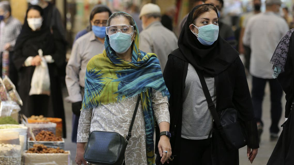 Mask-clad Iranians shop at the Tajrish Bazaar market in the capital Tehran, on November 1, 2020, amid the novel coronavirus pandemic crisis. Iran yesterday announced the expansion beyond Tehran of measures against Covid-19, amid growing calls for a full lockdown after the country posted a string of record highs in deaths and infections.