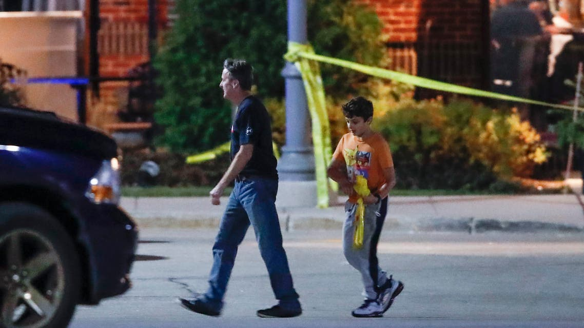 The mall shotting is the second such event in recent times. This file photo shows a man and a boy leave the Mayfair Mall in Wauwatosa, Wisconsin, on November 20, 2020, following a shooting. (AFP)