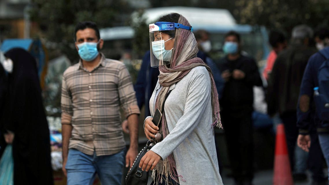 FILE PHOTO: An Iranian woman wears a mask and face shield, amid a rise in the coronavirus disease (COVID-19) infections, in Tehran, Iran October 24, 2020. Picture taken October 24, 2020. Majid Asgaripour/WANA (West Asia News Agency) via REUTERS ATTENTION EDITORS - THIS IMAGE HAS BEEN SUPPLIED BY A THIRD PARTY./File Photo