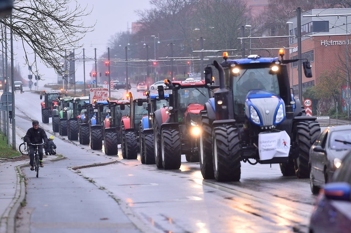 "Farmers in tractors demonstrate against ""abuse of power, lack of respect for the constitution, democratic deficit - and for democracy!"", in Aarhus, Denmark November 21, 2020. (Bo Amstrup/Ritzau Scanpix/via Reuters)"
