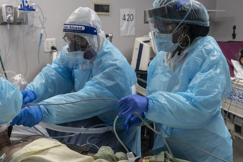 Medical staff members prepare for an intubation procedure on a patient suffering from the coronavirus disease (COVID-19) in the COVID-19 intensive care unit (ICU) at the United Memorial Medical Center on November 19, 2020 in Houston, Texas. (AFP)