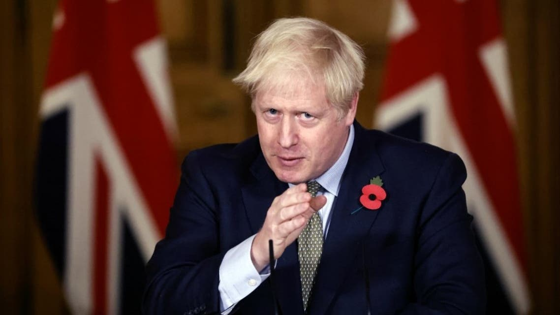 Britain's Prime Minister Boris Johnson speaks during a virtual press conference on the coronavirus pandemic in the UK inside 10 Downing Street in central London on November 9, 2020.  (AFP)
