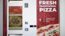 هرباً من إغلاق كورونا.. ماكينة تعطيك البيتزا بـ 3 دقائق