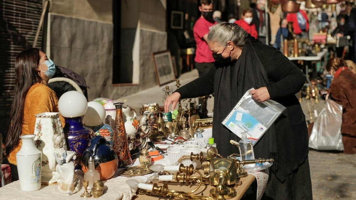 A woman shops at El Rastro flea market, amidst the coronavirus disease outbreak in Madrid, Spain November 22, 2020. (Reuters/Javier Barbancho)