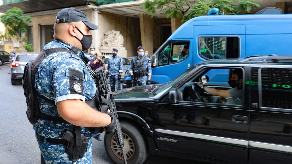 Lebanese policemen control cars at a checkpoint in the Sanayeh district of the Lebanese capital Beirut a day after the country went into lockdown, in a bid to stem the spread of the novel coronavirus, on November 14, 2020. (AFP)