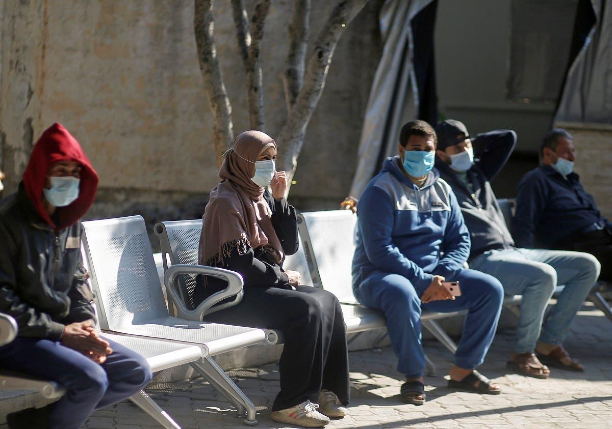 Palestinians wearing protective face masks sit at Shifa hospital amid the coronavirus disease (COVID-19) outbreak, in Gaza City November 22, 2020. (File photo: Reuters)