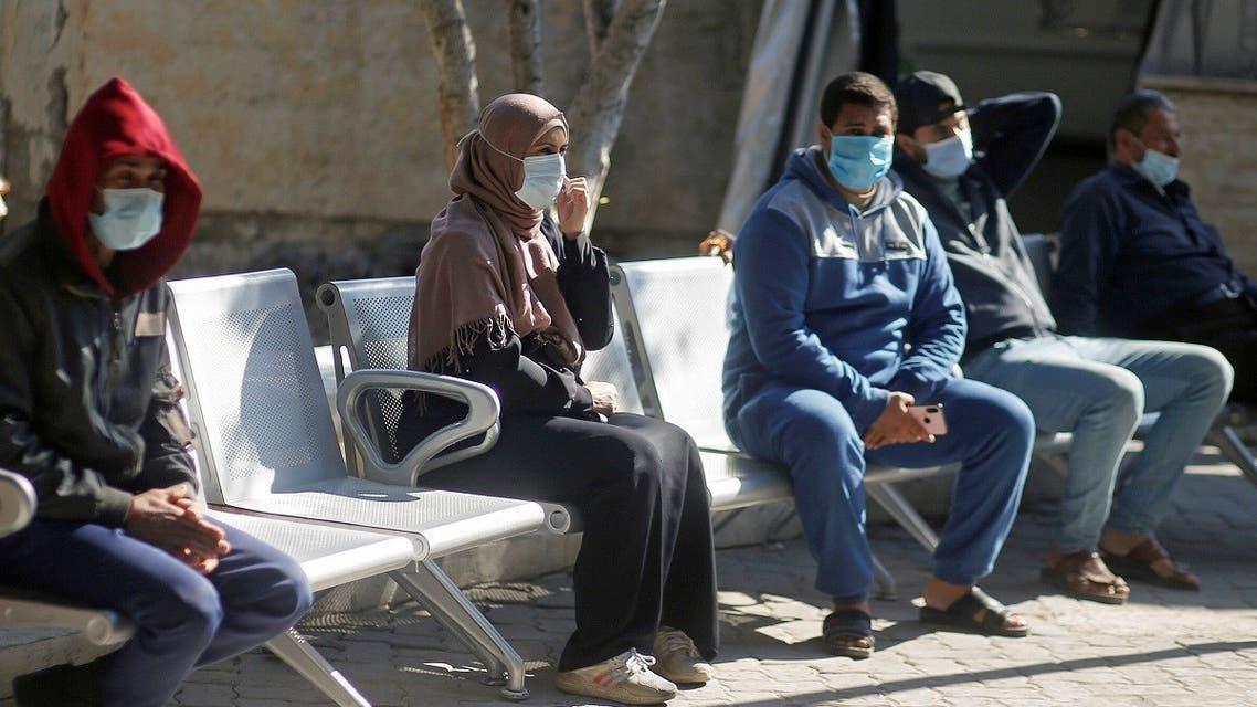 Palestinians wearing protective face masks sit at Shifa hospital amid the coronavirus disease (COVID-19) outbreak, in Gaza City November 22, 2020. (Reuters/Mohammed Salem)