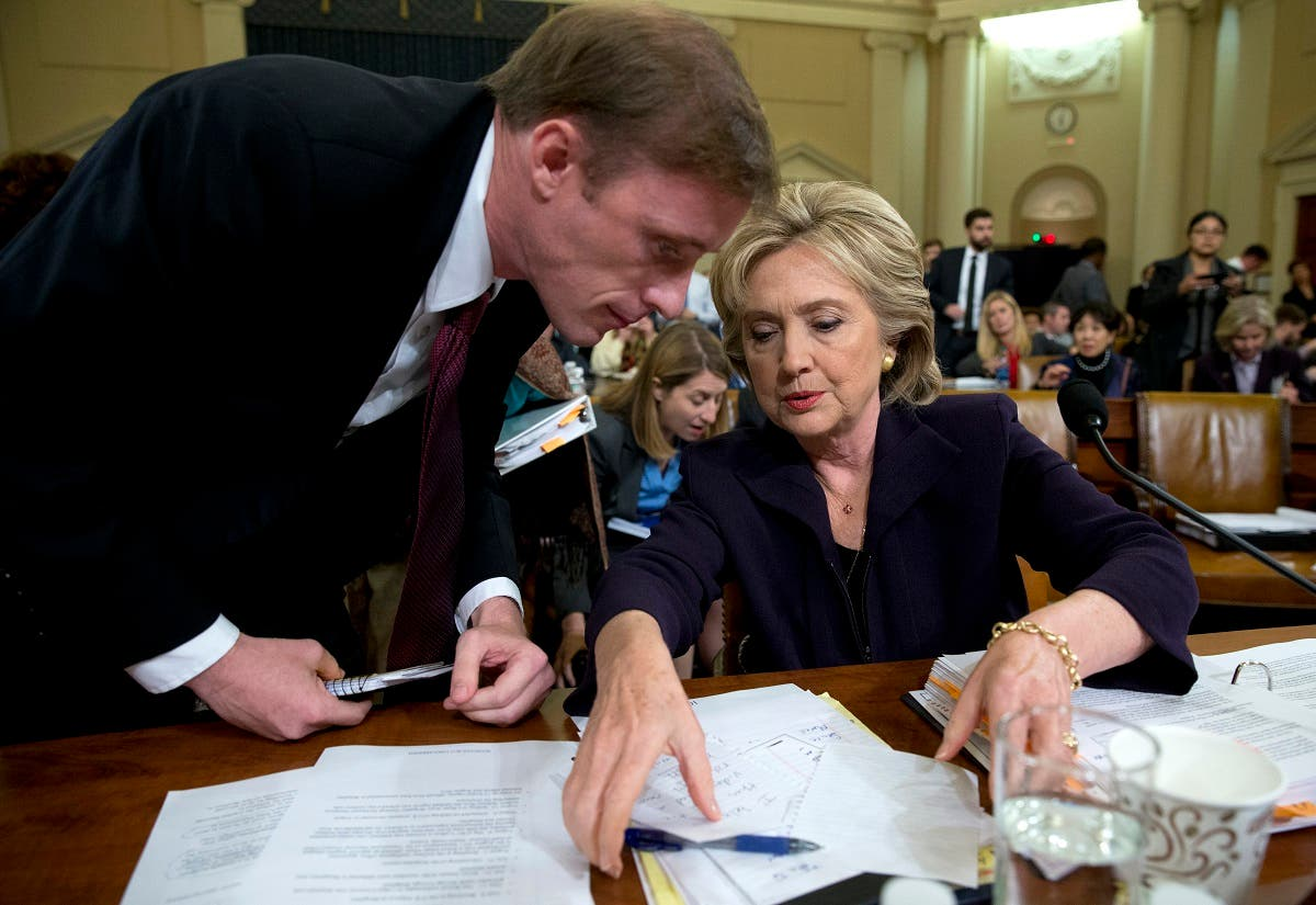Former Secretary of State Hillary Clinton talks with Jake Sullivan, a former staff member for her at the State Department, before the House Select Committee on Benghazi, Oct. 22, 2015. (AP)