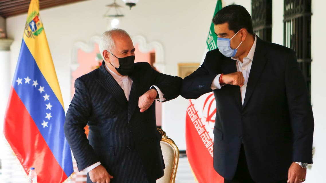 Venezuela's President Nicolas Maduro (R) bumping elbows with the Foreign Minister of the Islamic Republic of Iran, Javad Zarif (L) at Miraflores Palace in Caracas, on November 5, 2020. (AFP)