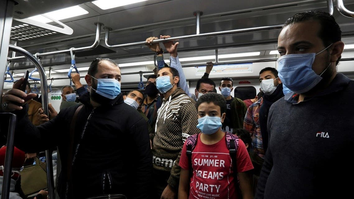People wearing protective face masks stand inside a train at a metro station in Cairo, Egypt November 21, 2020. (Reuters/Mohamed Abd el-Ghany)