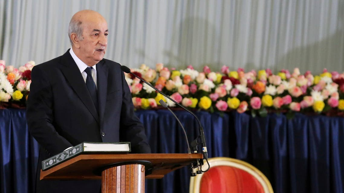 FILE PHOTO: Newly elected Algerian President Abdelmadjid Tebboune takes the oath during a swearing-in ceremony in Algiers, Algeria December 19, 2019. REUTERS/Ramzi Boudina/File Photo