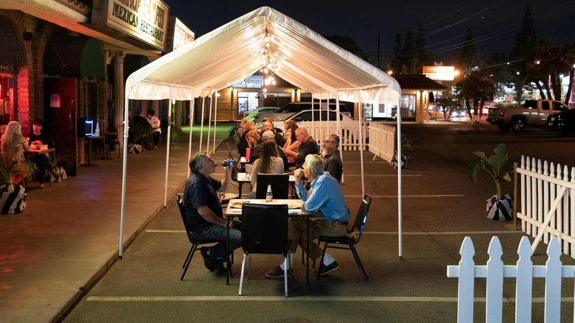 People dine in a tent temporarily set up in the parking lot of a restaurant in La Habra, California, Nov. 17, 2020. (AP)