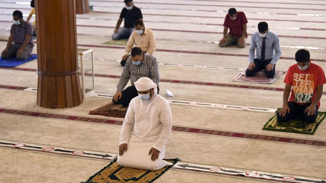 Worshippers keeping a safe distance from one another perform prayers at a mosque in UAE after reopening places of worship following months of closure to avoid the spread of the Covid-19. (AFP)