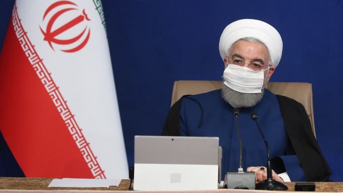 A handout picture provided by the Iranian presidency shows President Hassan Rouhani wearing a protective mask due to the COVID-19 coronavirus pandemic while chairing a cabinet meeting in the capital Tehran on November 11, 2020. (AFP)