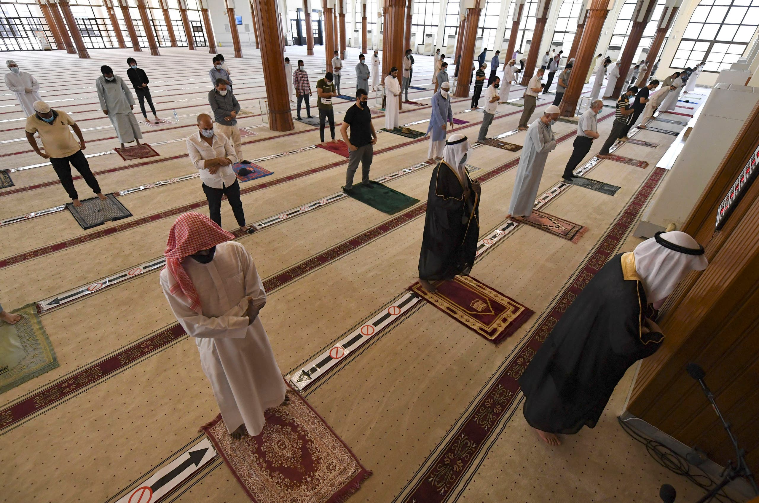 Worshippers keeping a safe distance from one another perform prayers at a mosque in the emirate of Sharjah in the United Arab Emirate.