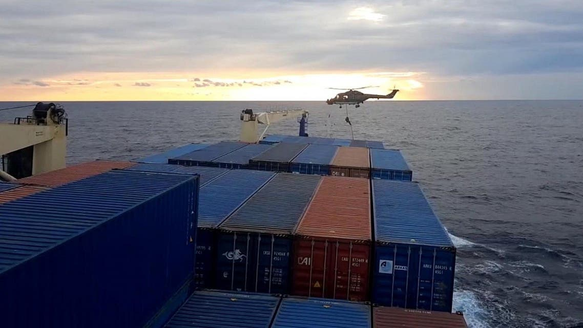 A screen grab made from a video released by Demiroren News Agency shows a German soldier landing from a helicopter on a Turkish cargo ship on November 23, 2020 at east Mediterranean sea. (Demiroren News Agency (DHA)/AFP)