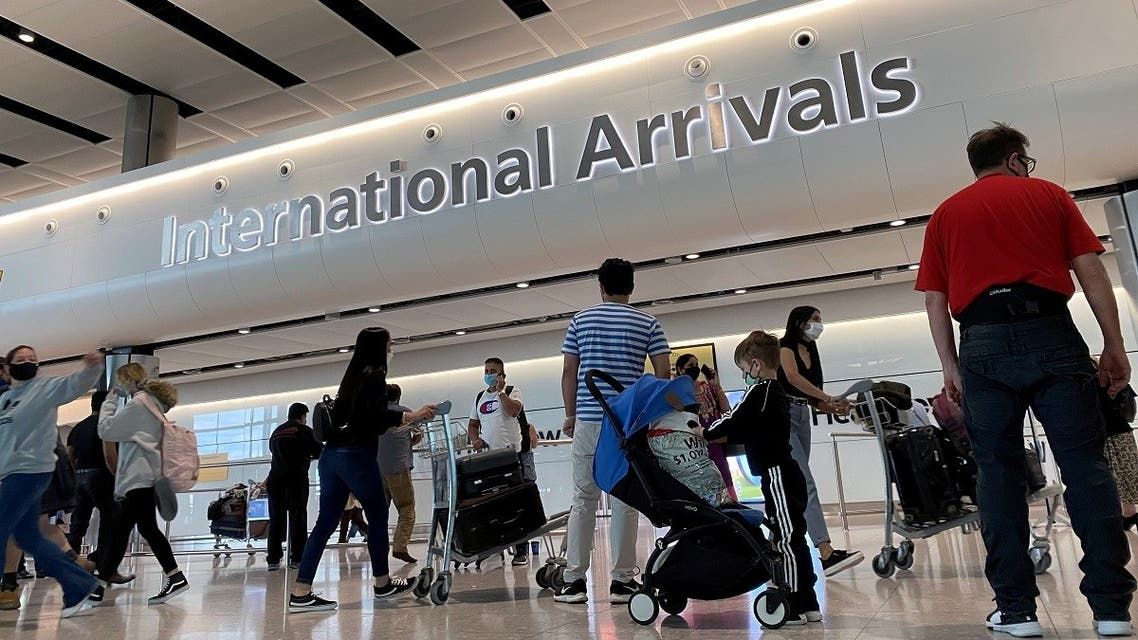 Passengers from international flights arrive at Heathrow Airport, following the outbreak of the c