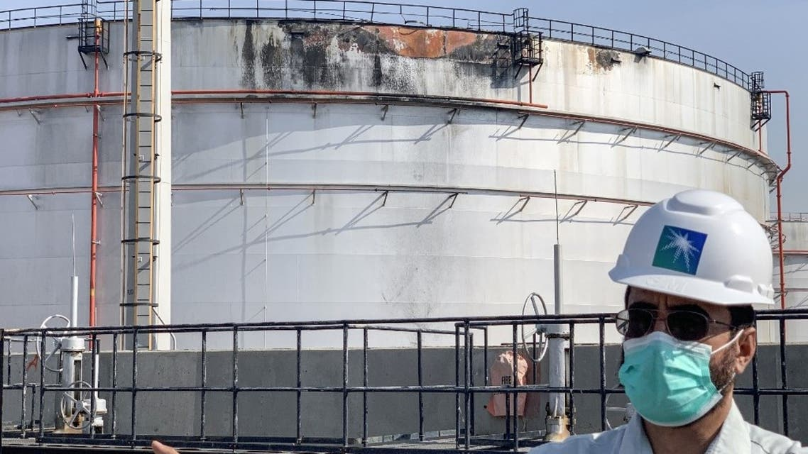 An employee at the Saudi Aramco oil facility gestures while standing near a damaged silo, at the plant in Saudi Arabia's Red Sea city of Jeddah on November 24, 2020. (AFP)