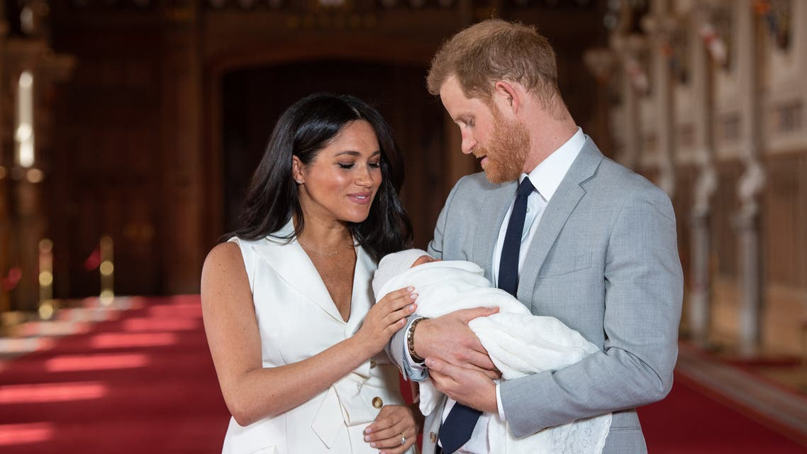 (FILES) In this file photo taken on May 08, 2019 Britain's Prince Harry, Duke of Sussex (R), and his wife Meghan, Duchess of Sussex, pose for a photo with their newborn baby son, Archie Harrison Mountbatten-Windsor, in St George's Hall at Windsor Castle in Windsor, west of London on May 8, 2019. Meghan Markle has revealed she suffered a miscarriage in July this year, writing in the New York Times on November 25, 2020 of the deep grief and loss she endured with her husband Prince Harry.