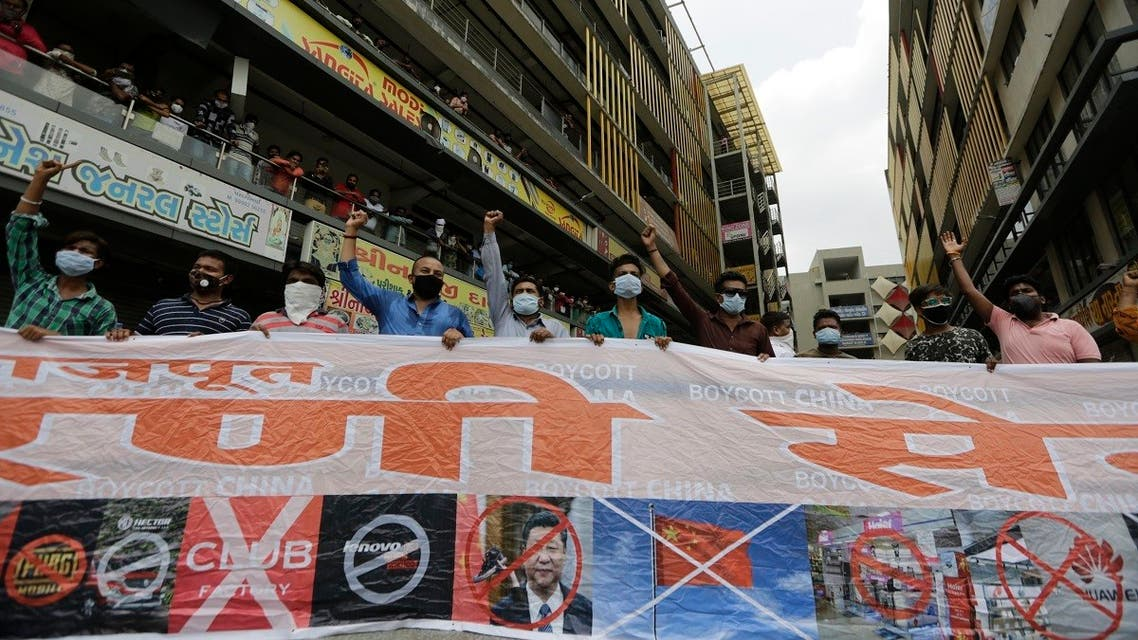 Activists display a banner and shout slogans during a protest against China outside a mobile phone market in Ahmedabad, India. (File photo: AP)