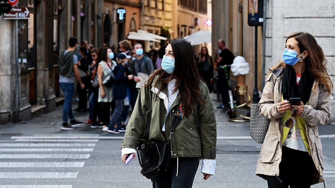 Women walk in downtown Rome, on October 25, 2020, as the country faces a second wave of infections to the coronavirus. (Vincenzo Pinto/AFP)